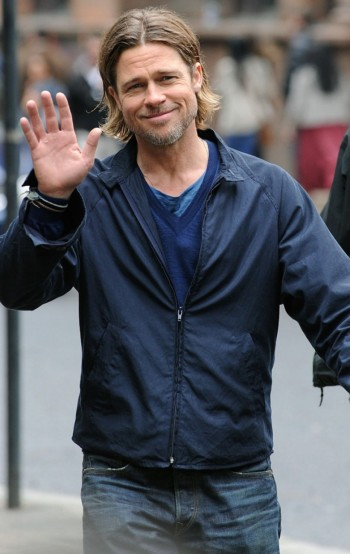The affable Brad Pitt waves to a photographer on the Glasgow set of World War Z. Many set shots like this show more details of the actual jacket and outfit than are clearly seen in the fast-moving, and often dark, action on screen.