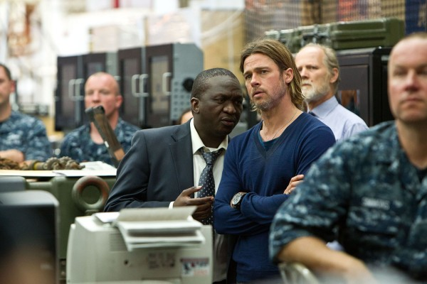 Production photo of Fana Mokoena as Thierry Umutoni with Brad Pitt as Gerry Lane in World War Z (2013).