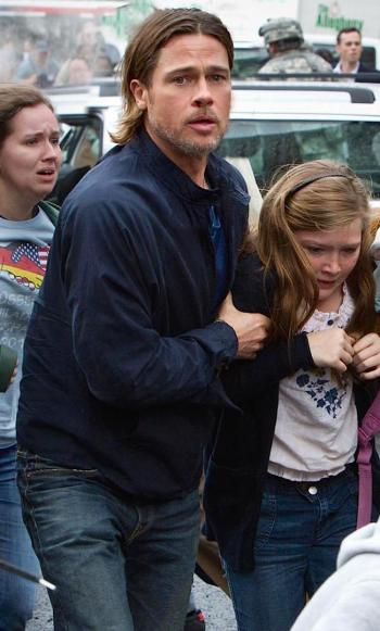Brad Pitt and Abigail Hargrove in World War Z (2013)