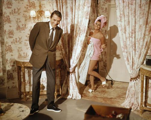 Fun with Gregory Peck and Sophia Loren on the set of Arabesque (1966). Note that Peck has evidently changed out of his character's brown suede derby shoes and into a pair of black-and-white sneakers.