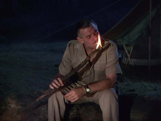 With moments like this, where Gable's character lights a cigarette using the fiery end of a campfire stick, the actor had little reason to worry about losing his reputation for ruggedness.