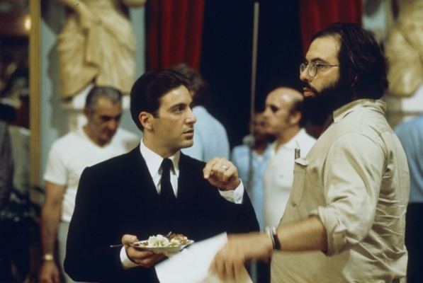 Al Pacino takes direction from Francis Ford Coppola on the set of The Godfather Part II (1974).