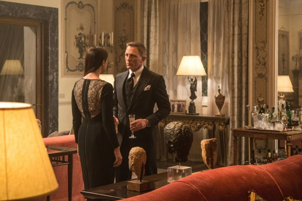 "Production photo of Monica Bellucci and Daniel Craig in Spectre, highlighting his sharp black Tom Ford ""Windsor"" three-piece suit."