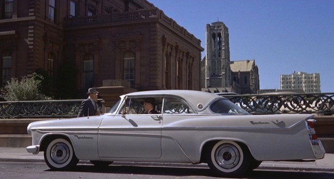 Scottie Ferguson pulls up in his white DeSoto.