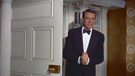 Grant wears a three-piece tuxedo with a peak-lapel dinner jacket in Indiscreet (1958)...