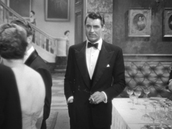 ...shades of a similar black tie ensemble he wore 12 years earlier in Notorious (1946), also starring Ingrid Bergman.