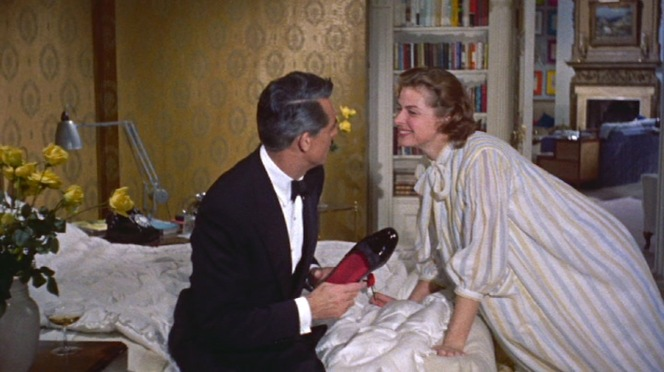 Philip makes a point of his elegant sartorialism by keeping his patent leather pumps in hand while gesticulating around Anna's room.
