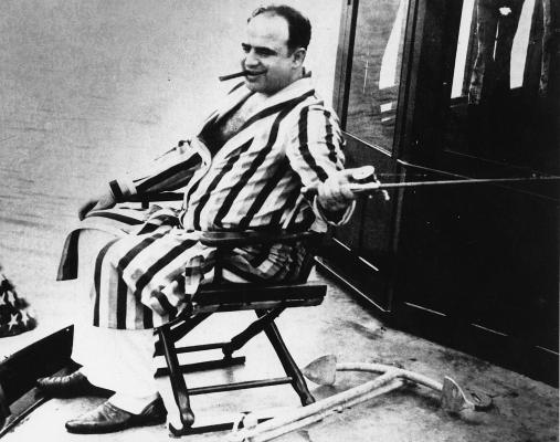 Big Al himself, clad in a striped robe while fishing off the Florida coast, circa 1930.