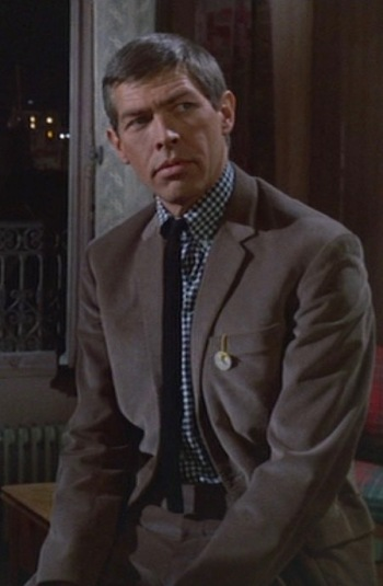 James Coburn as Tex Panthollow in Charade (1963)
