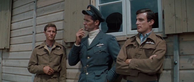 In his heroic blue-gray service uniform and cap, Hendley stands out against some of the other downed airmen in their old 1937 pattern brown woolen battle dress garments.