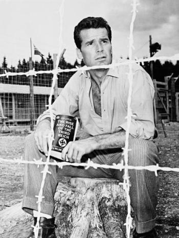 James Garner on the set of The Great Escape, reading William L. Shirer's The Rise and Fall of the Third Reich. It would have been quite a victory for Hendley to scrounge a book that wouldn't be published until 1960, but I wouldn't put it past him!