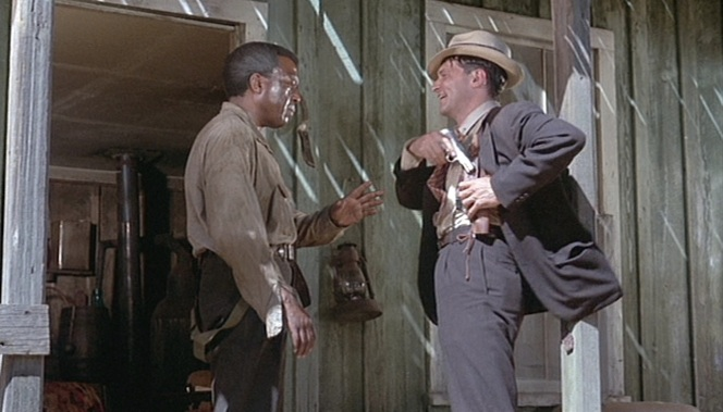 Eddie reholsters his Colt during a conversation with Johnny Hutchins (Dots Johnson).
