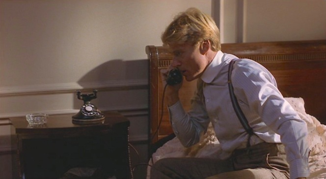 Roy Hobbs takes a phone call that he should have avoided.