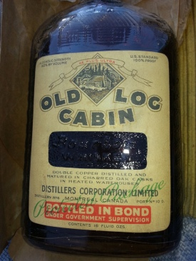 A bottle of Old Log Cabin, distilled in Montreal and dated 1927. (Source: DrinksPlanet.com)