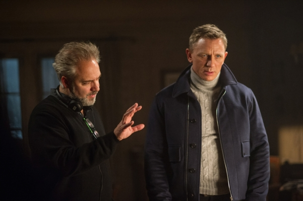 Sam Mendes directs Daniel Craig on the set of Spectre. The open jacket gives us a better look at the cable-knit cashmere turtleneck than we get in the finished film.