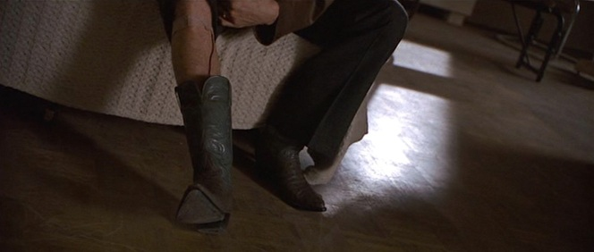 The source of Donnie's anxiety: a wired tape recorder hidden in his boot.
