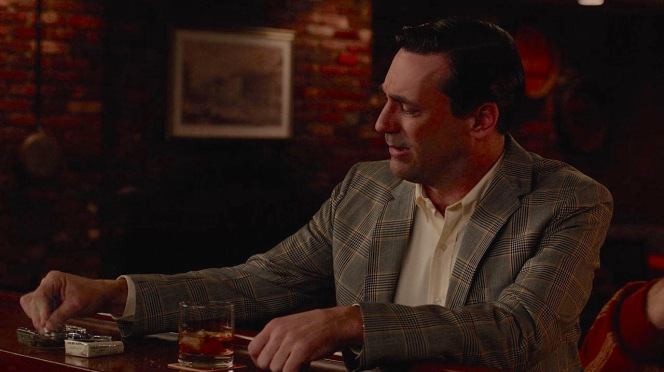 A familiar image: Don Draper with an Old Fashioned and a pack of cigarettes, though he's switched from his Luckies of earlier seasons to Old Golds after Lucky Strike left his agency at the end of the fourth season.