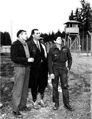 Cast members James Coburn and Charles Bronson are joined by Wally Floody on the set of The Great Escape, 1962. Floody was one of the real-life Stalag Luft III tunnel diggers. He survived the war and, almost 20 years after the escape, assisted the filmmakers as a technical advisor. Source: Catherine Floody, via Beach Metro Community News