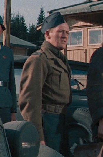 "Gordon Jackson as Flight Lieutenant Andrew ""Mac"" Macdonald in The Great Escape (1963)"