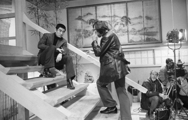 Ken Tanaka takes a smoke break on the set of The Yakuza.