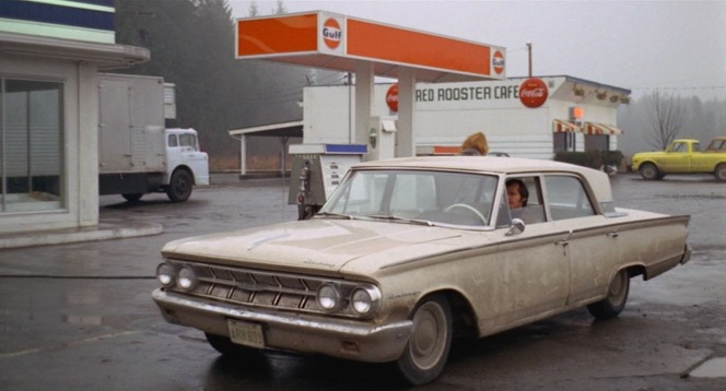 Bobby pulls his Mercury into a service station.