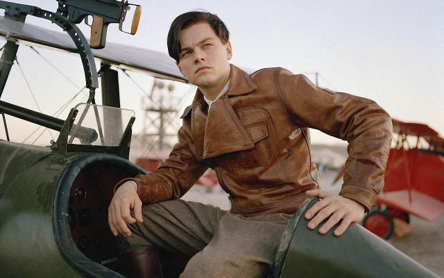 Promotional photo of Leonardo DiCaprio as Howard Hughes in The Aviator, sporting a tanned leather Belstaff flying jacket.