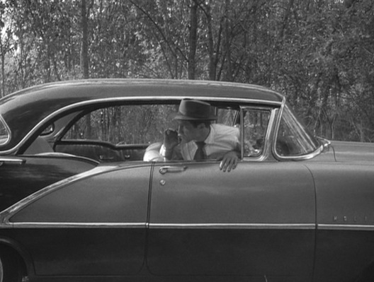 Michel sits in the car that started it all, a 1956 Oldsmobile 88 Holiday Sedan.