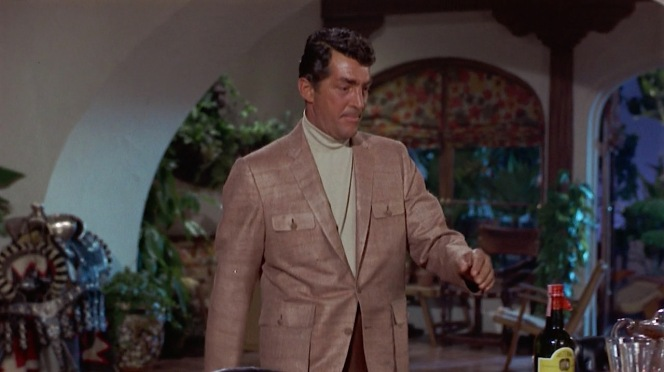 Matt Helm gets home and promptly reaches for a bottle of Scotch. Dean Martin's influence on the character is very thinly veiled, indeed.