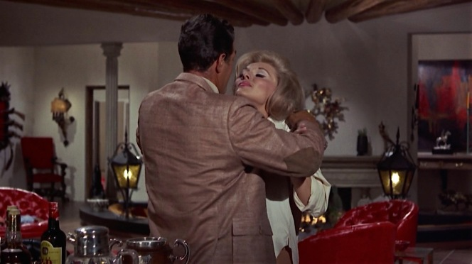 Only a blonde bombshell can get Matt Helm to turn his back on a bottle of Scotch.