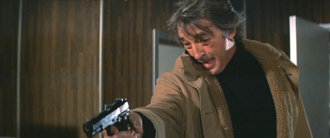 Note the large muzzle bore, indicating that Harry is likely armed with a genuine blank-firing .45 than a 9mm substitute.