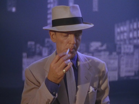 """Rod lights yet another cigarette over the course of his """"investigation""""."""
