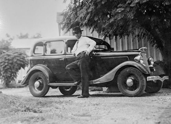 The real Frank Hamer in 1934 with the black Ford V8 he drove for thousands of miles that spring in pursuit of Bonnie and Clyde.