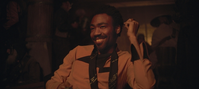 Lando's slim black scarf with the irregular bright lines was reportedly inspired by the Death Star's corridors seen in A New Hope.