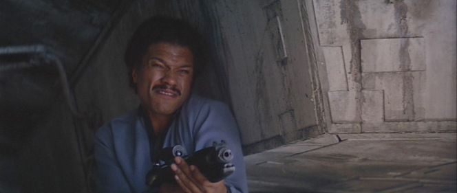 Note the spent cartridge casing being ejected from the right side of Lando's blaster.