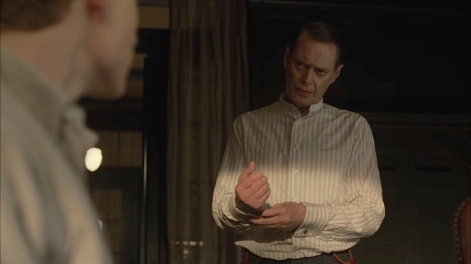 """Nucky snaps his cuff links together while talking with his nephew in """"The Old Ship of Zion"""" (Episode 4.08)."""