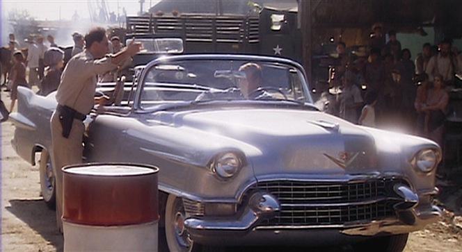Jack glides his Cadillac through a Cuban checkpoint.