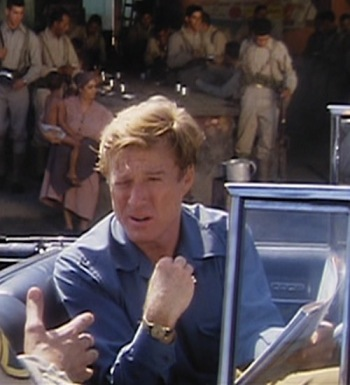 Robert Redford as Jack Weil driving a 1955 Cadillac in Havana (1990)