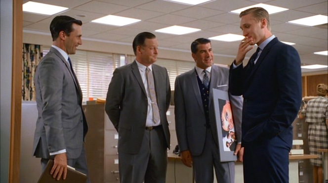 "Sterling Cooper's creative team consults after a successful pitch in ""The Hobo Code"" (Episode 1.08)."