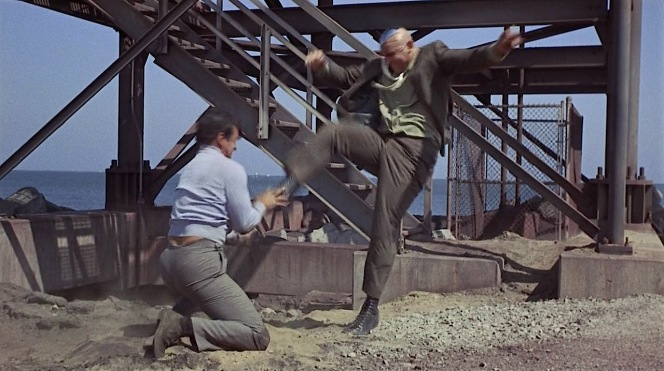 The suede chukka boots absorb much of the ground sand as Matt fights Dr. Wall's henchmen.