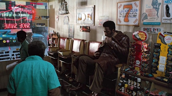 Shaft starts his day with a cup of coffee and a shoeshine.