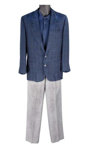 Tom Cruise's screen-worn navy linen-blend Bobby Yosten sports coat, navy cotton Carroll and Company polo, and black-and-gray herringbone slacks from Rain Man. Worn on at least three occasions on screen, this is as close as Charlie has to a signature outfit. (Source: iCollector)