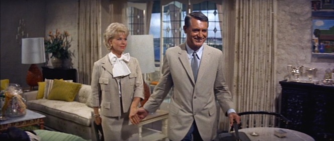 Beige has been Cathy's signature color up to this point in That Touch of Mink, and Philip matching her with his summer sports coat shows that they're truly in sync for the first time in the movie, particularly as she is outfitted in the new Bergdorf Goodman suit that Philip paid for and coordinated with the help of the laconic Leonard.