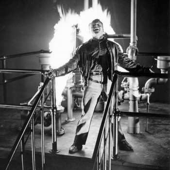 Production photo of James Cagney during White Heat's iconic final scene.