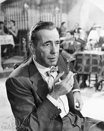 Humphrey Bogart as Harry Dawes in an MGM studio portrait for The Barefoot Contessa (1954)