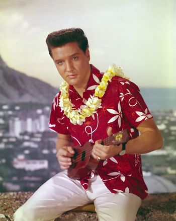 Elvis Presley in promotional art for Blue Hawaii (1961). His character Chad Gates never actually wore this actual shirt on screen, instead wearing a differently patterned red Aloha shirt.
