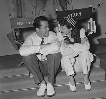 Lifelong friends Henry Fonda and Barbara Stanwyck share a smile on the set of The Lady Eve.