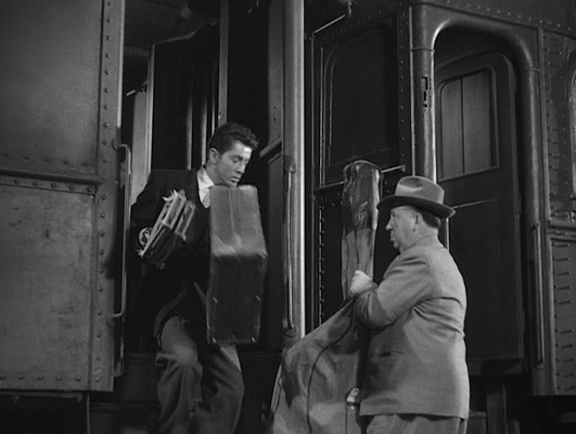 Alfred Hitchcock's trademark cameo in Strangers on a Train was directed by his daughter Patricia, who would also star in the film as Barbara Morton, younger sister of Guy Haines' sophisticated love interest Anne Morton (Ruth Roman).