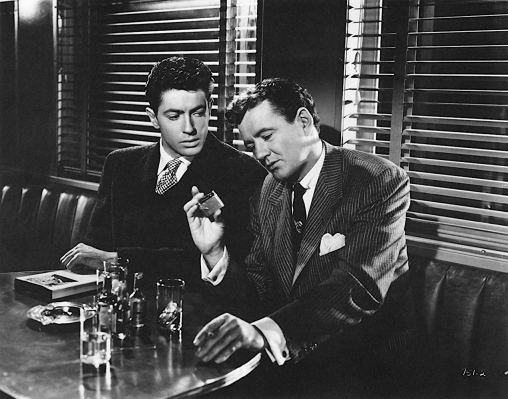 Production photo of Farley Granger and Robert Walker in Strangers on a Train.