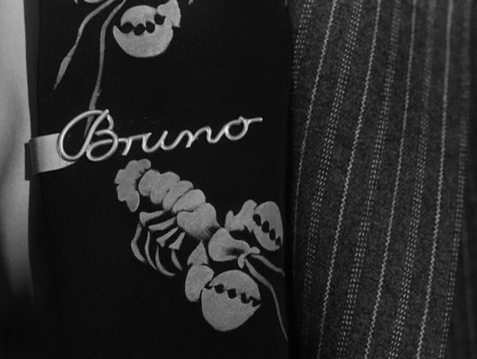 """Well, I suppose you think it's corny, but my mother gave it to me, so I have to wear it to please her,"" Bruno overshares, establishing his twist on the classic Oedipal complex within seconds of making Guy's acquaintance."