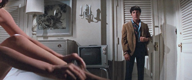 One of the most enduring images from The Graduate is Benjamin, half-dressed and exhausted from arguing, as Mrs. Robinson pulls up her stockings in the foreground.